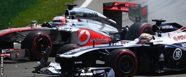 Jenson Button and Pastor Maldonado