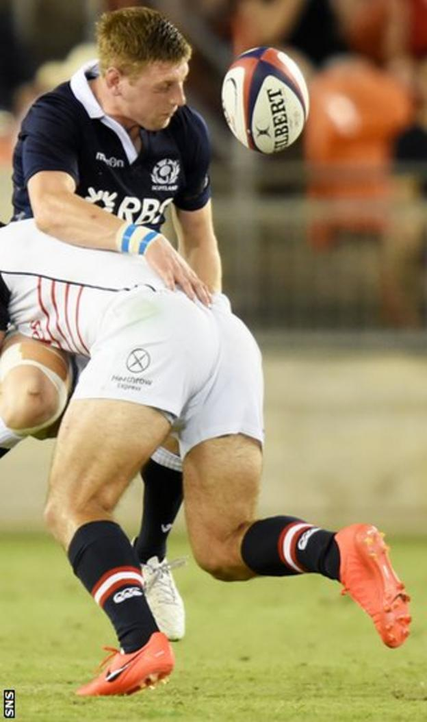 Scotland's Finn Russell (left) is tackled by Seamus Kelly