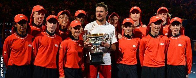 Stanislas Wawrinka celebrates his Australian Open win with the ball boys and girls