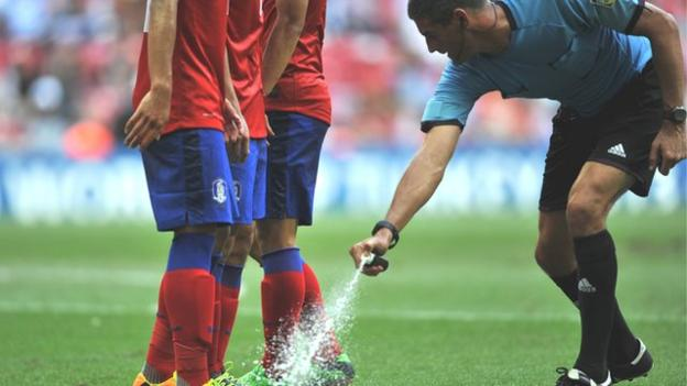 New Zealand referee Peter O Laary sprays the grass before a free-kick during a match between South Korea and Nigeria at last year's Under-20 World Cup