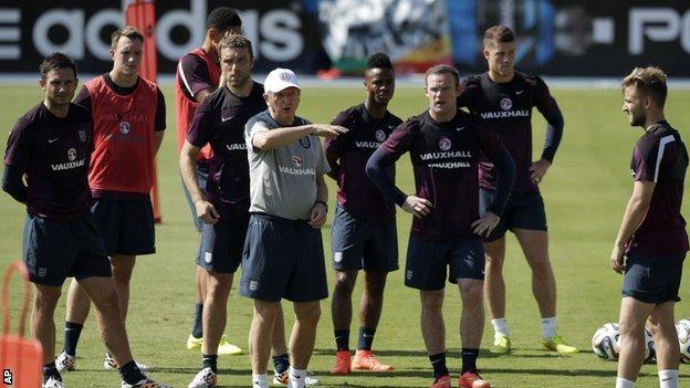 England manager Roy Hodson (second right) during training