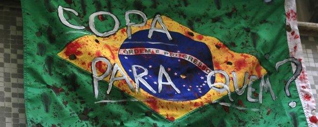 A Brazil flag hangs from a window
