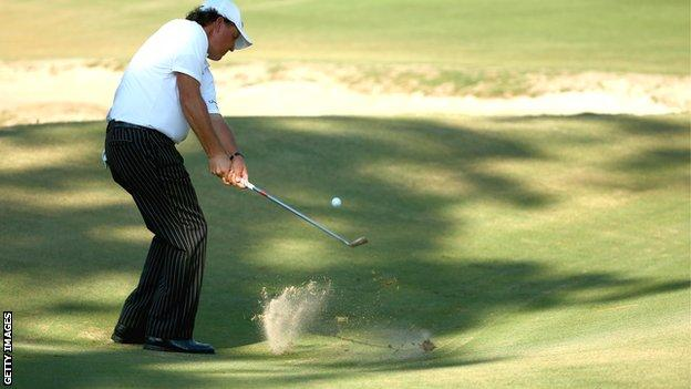 Phil Mickelson chips during US Open practice at Pinehurst