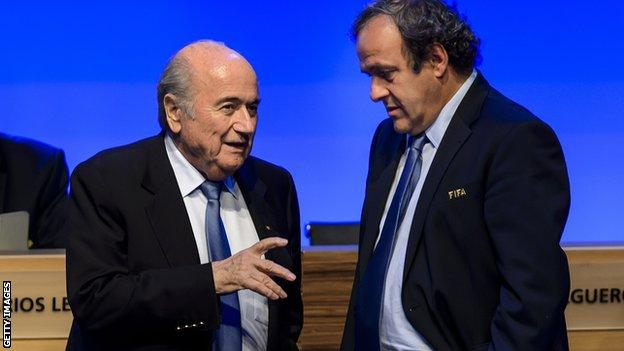 Sepp Blatter talks to his counterpart, and potential rival for office, Michel Platini in Sao Paulo