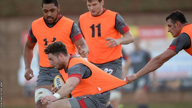 Aaron Shingler tries to stop Alex Cuthbert in his tracks during a Wales squad training session