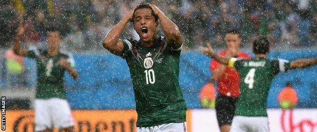 Giovani Dos Santos shows his frustration at having a goal disallowed against Cameroon