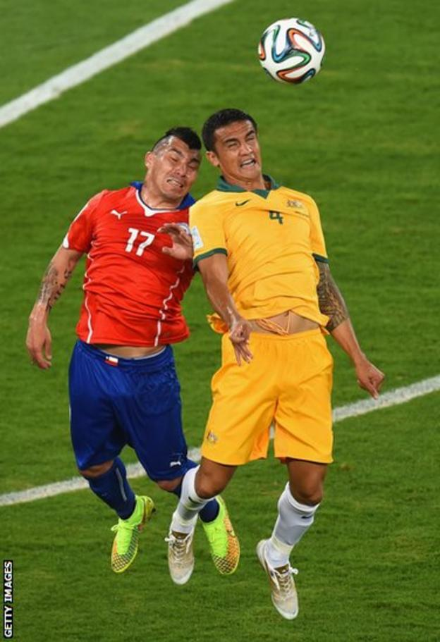 Cardiff City's Gary Medel challenges Tim Cahill during Chile's 3-1 win over Australia in the World Cup.