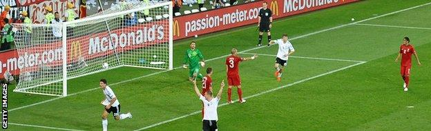 Germany's Mario Gomez (left) scores against Portugal at Euro 2012