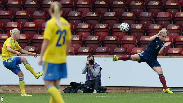 Caroline Seger curls home the opening goal for Sweden