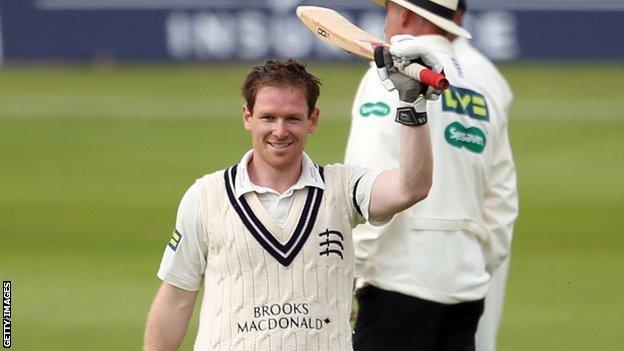Eoin Morgan raises his bat to mark his second century in successive Championship matches