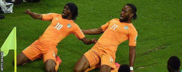 Gervinho (left) celebrates scoring with Didier Drogba as Ivory Coast came from behind to beat Japan at the World Cup