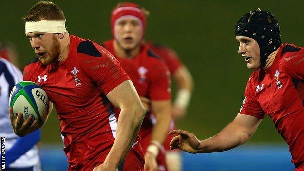 Jack Dixon makes a break for Wales Under-20
