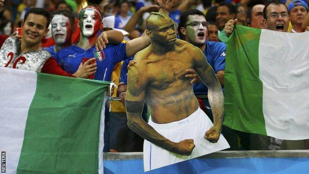 Italian fans with Mario Balotelli cut out