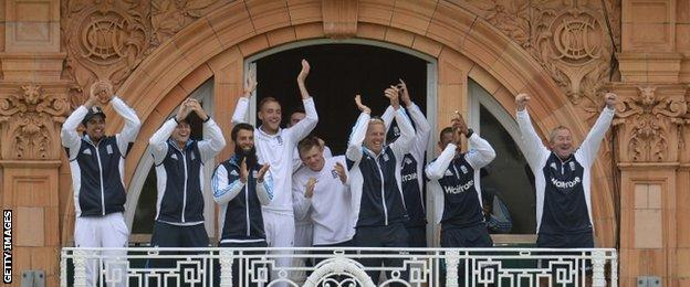 The England team applaud after Gary Ballance reaches his debut Test century against Sri Lanka