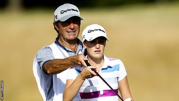 Lucy Williams receives instruction from her father David