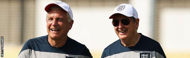 Sir Trevor Brooking & Roy Hodgson share a joke during an England training session