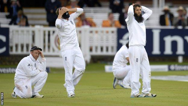 England's slips hold their hands to their heads