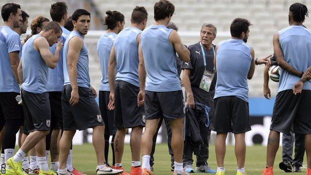 Uruguay coach Oscar Tabarez speaks to his players during training