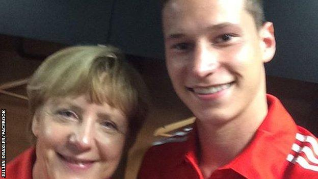 Germany Chancellor Angela Merkel and Germany player Julian Draxler