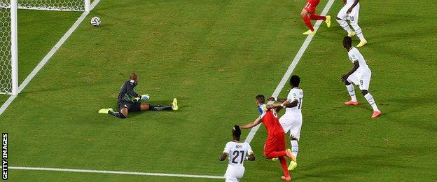USA striker Clint Dempsey (centre) scores against Ghana in their Group G game