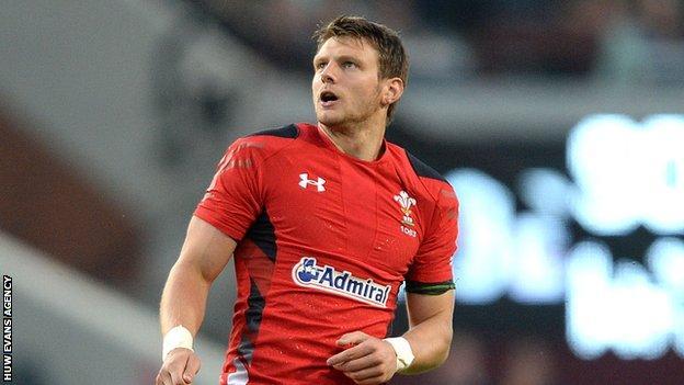 Dan Biggar of Wales watches his drop goal go through the posts