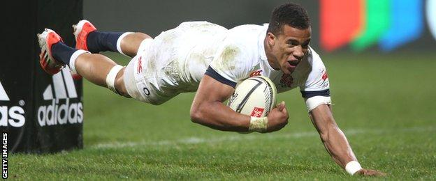 Anthony Watson dives over to score for England