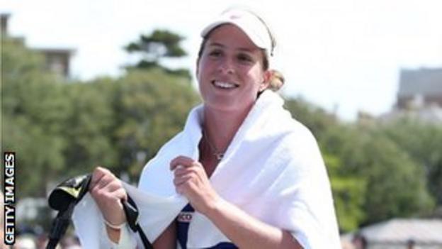 Johanna Konta of Great Britain smiles after beating Swiss Belinda Bencic