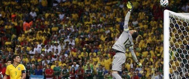 Brazil goalkeeper Julio Cesar tips over a Hector Herrera shot