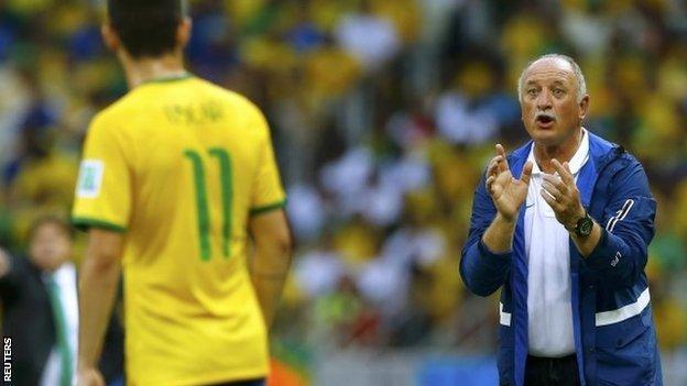 Brazil's coach Luiz Felipe Scolari talks to Oscar