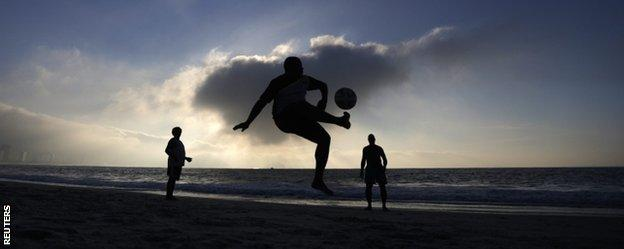People playing football on the Copacabana beach in Rio de Janeiro