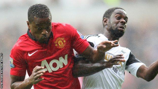 Patrice Evra of Manchester United and Nathan Dyer of Swansea City