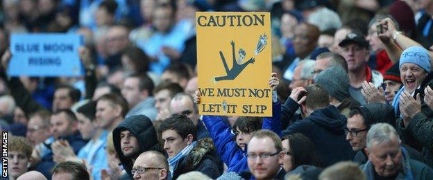 A Manchester City fan taunts Liverpool's Steven Gerrard during the title run-in