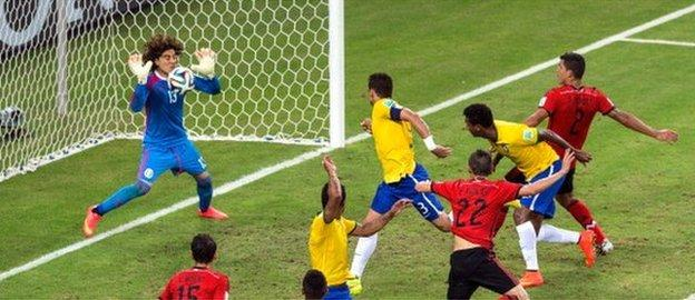 Brazil's Thiago Silva is denied by Mexico keeper Guillermo Ochoa