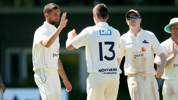Mark Adair celebrates after bowling Fintan McAllister