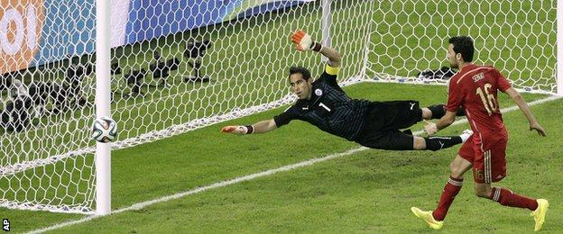 Spain midfielder Sergio Busquets shoots wide from five yards against Chile