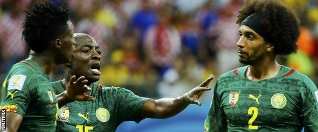 Cameroons Pierre Webo (centre) tries to separate team-mates Benjamin Moukandjo (left) and Benoit Assou-Ekotto