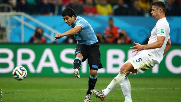 Luis Suarez scores Uruguay's second goal against England at the 2014 World Cup