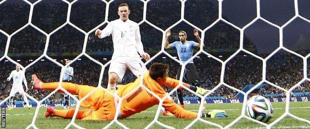 Wayne Rooney's first goal at a World Cup finals put England level.