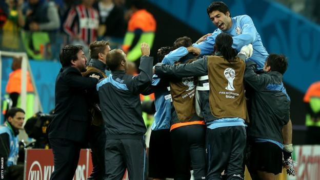 Goal hero Suarez celebrates the 2-1 win with staff and team-mates