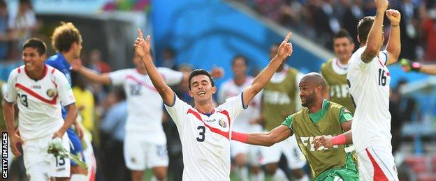 Costa Rica players celebrate after defeating Italy at the 2014 World Cup
