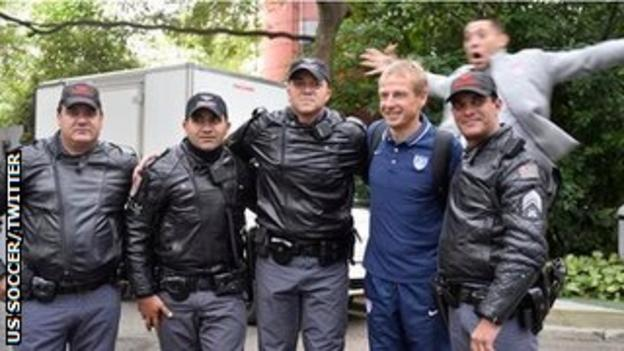 USA coach Jurgen Klinsmann (second from left) and striker Clint Dempsey (top)