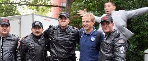 USA coach Jurgen Klinsmann, second from right, and striker Clint Dempsey (top)
