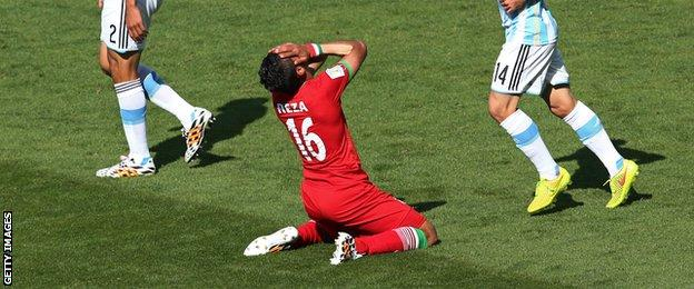Iran's Reza Ghoochannejhad reacts after a missed chance against Argentina