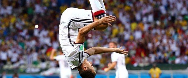 Klose celebrates a goal with his customary front flip.