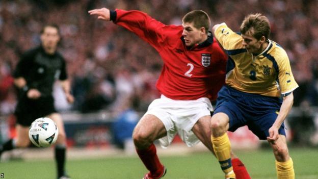 England midfielder Steven Gerrard battles for possession of the ball with Ukraine's Anatoliy Tymoschuk