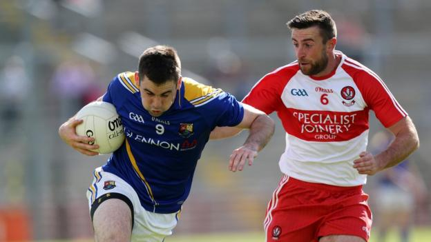 Kevin Diffley attempts to make ground for Longford as Mark Craig of Derry closes in during the All-Ireland first round qualifier