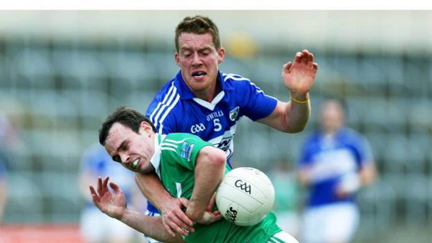 Paul McCusker and Darren Strong vie for possession as Fermanagh go down 1-19 to 2-15 to Laois