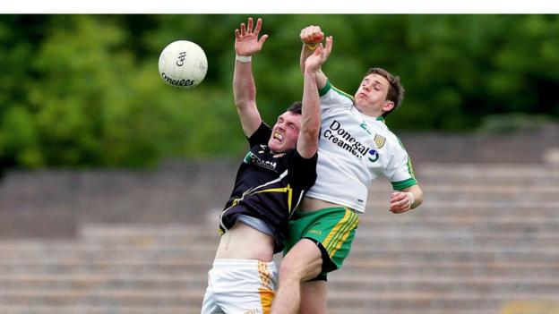 Antrim's James Laverty and Donegal's Darach O'Connor contend for a high ball during the Ulster Football semi-final at Clones