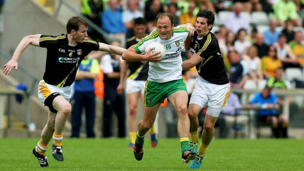 Colm McFadden tries to escape the clutches of Kevin Boyle and Justin Crozier as Donegal see off Antrim