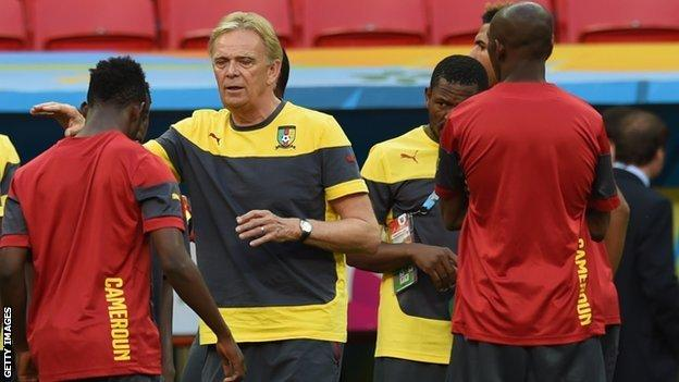 Cameroon coach Volker Finke (centre) gives out instructions during training